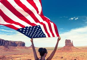 girl with us flag in desert